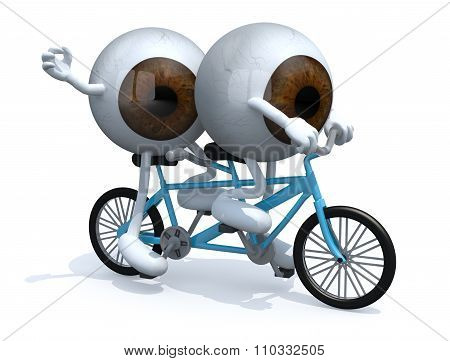 Two Brown Eyeballs Riding Tandem