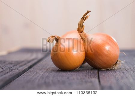 Three Vibrant Ripe Onions