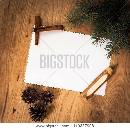 blank sheet of paper on the wooden floor with a pencil