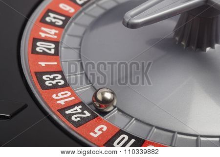 Casino Roulette Detail With Ball In Number Twenty Four. Gambling