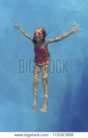 Young Girl Floating On Water Surface
