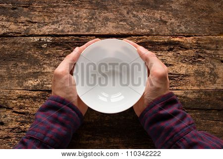 Man Holding A White Empty Cup On A Wooden Background