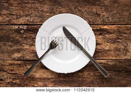Knife And Fork On The Plate Are As A Pause Symbol