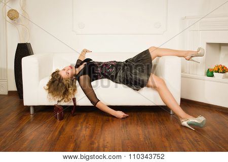 Lifeless Woman Lying On Sofa