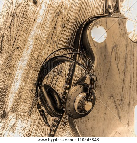 Electric Guitar And Headphones In Sepia Tone