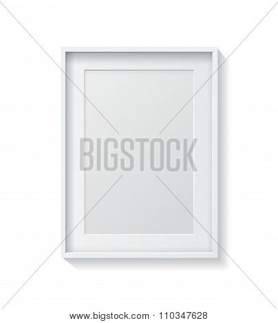 Realistic White Blank Picture Frame, Hanging On A White Wall From The Front.