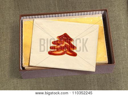 Christmas message with wax seal and other documentation on retro background
