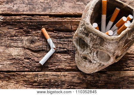Cigarette In The Ashtray In The Form Of A Skull Smoking Kills Concept