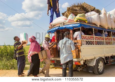 People Loading Cargo And Luggage On Local Public Transport Vehicle