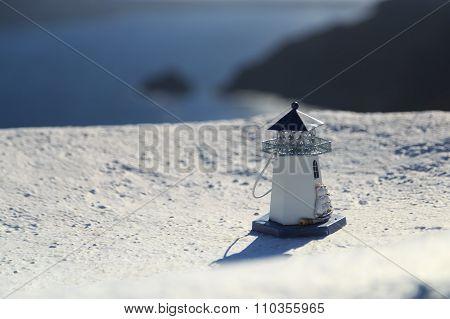 Souvenir Lighthouse On The Parapet Overlooking The Aegean Sea