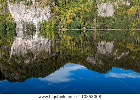 Autumn Reflections Of A Steep Cliff