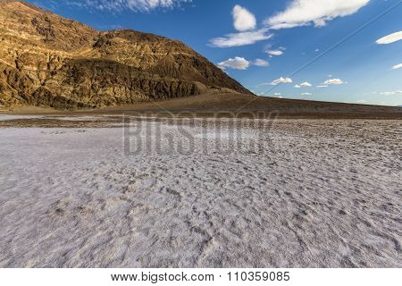 On white salt inside Death Valley at extreme heat, USA