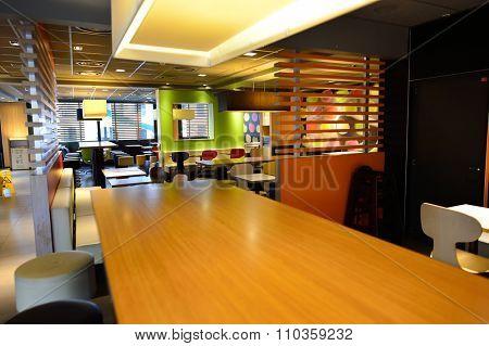 GENEVA, SWITZERLAND - NOVEMBER 19, 2015: McDonald's restaurant interior. McDonald's is the world's largest chain of hamburger fast food restaurants, founded in the United States.