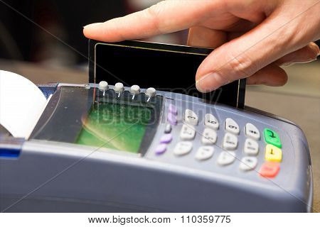 Hand Swiping Blank Credit Card In Store