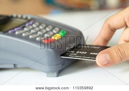 Hand Push Credit Card Into A Credit Card Machine : Selective Focus