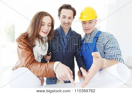 Foreman Shows House Plans To Couple