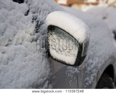 car mirror under the snow