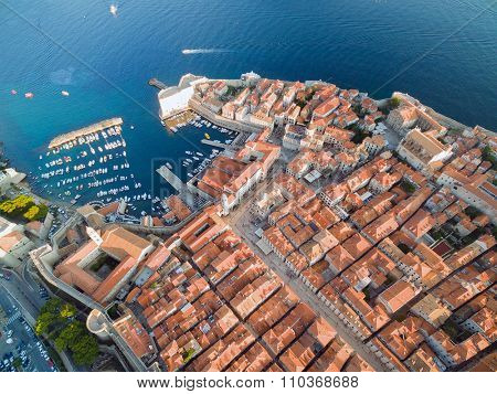 Aerial view of old city of Dubrovnik (Croatia) above Stradun and port, popular tourist attraction on Adriatic.