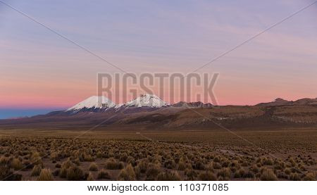 Sunset In Andes. Parinacota And Pomerade Volcanos.