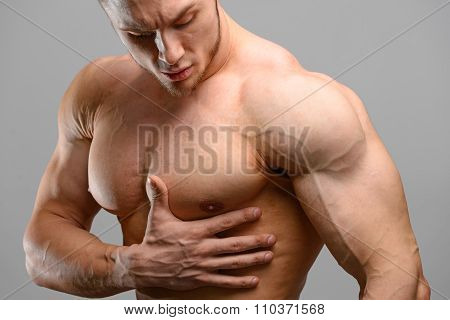 Pain in the heart of a bodybuilder man