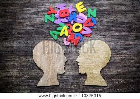 Heads silhouette with letters