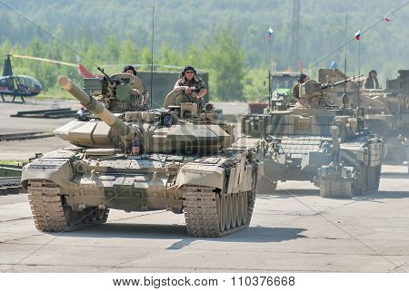 Modernized tank T-72 and convoy in motion. Russia