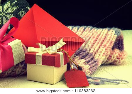 Red envelope, christmas gift boxes and winter scarf