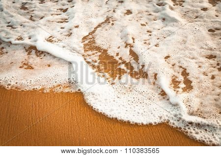 Yellow Sand And Smooth Ocean Water With A Bubbles