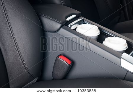 Paper Coffee Cups Inside Car Cup Holder.