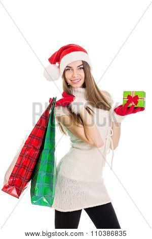 Happy teenage girl with Christmas presents