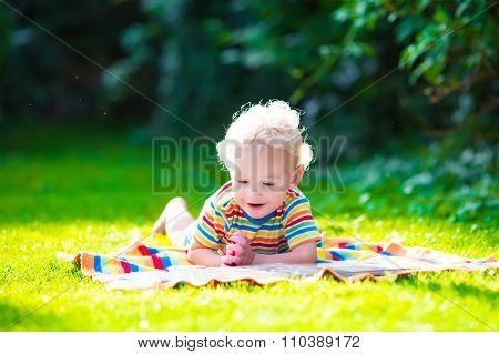 Two Kids Reading In Summer Garden