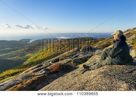 Mature Man Enjoying View from Mountain