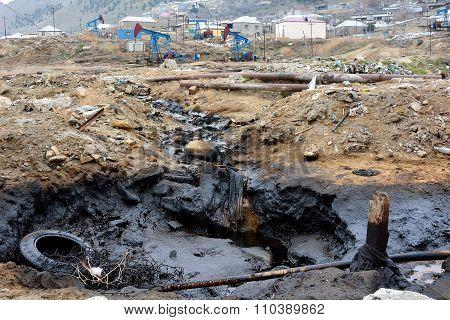 Oil pollution flowing from pumps on-shore in Baku, Azerbaijan