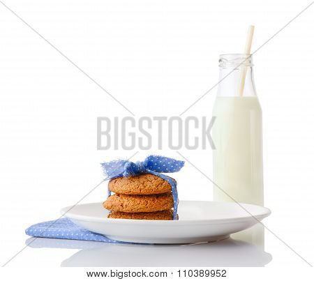 Stack of three homemade oatmeal cookies tied with blue ribbon in small white polka dots on white cer