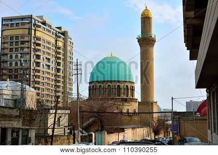 Blue roof and minaret of Sultanbey mosque, in Baku, Azerbaijan