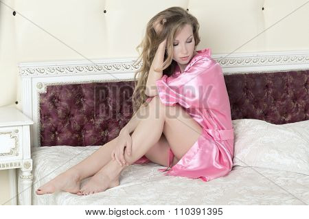 luxurious blond woman in pink silk