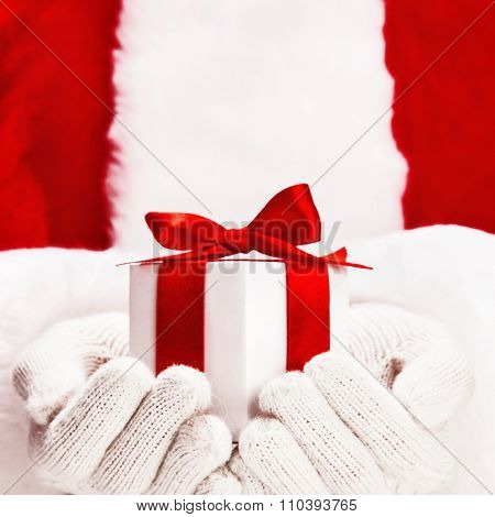 Santa Claus with gifts in hands closeup