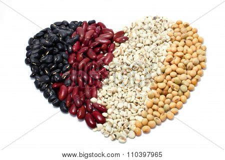 The Heart Of Varieties Of Beans On White Background, Job Tear, Soy Bean, Black Bean,  Red Kidney Bea
