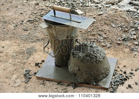 The slump test equipment. Wet concrete was compacted for the slump test.