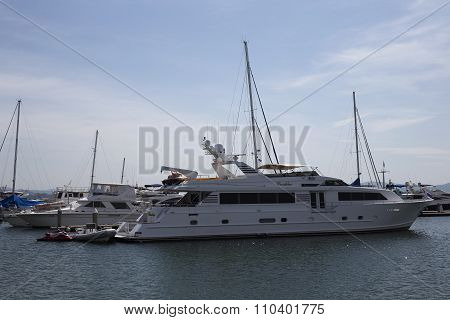 The White Yacht Anchored At Harbor