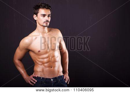 Handsome shirtless man on grunge backgound