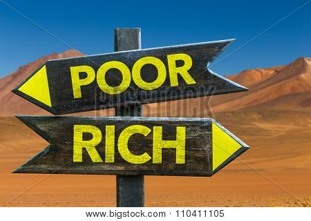 Poor - Rich signpost in a desert background