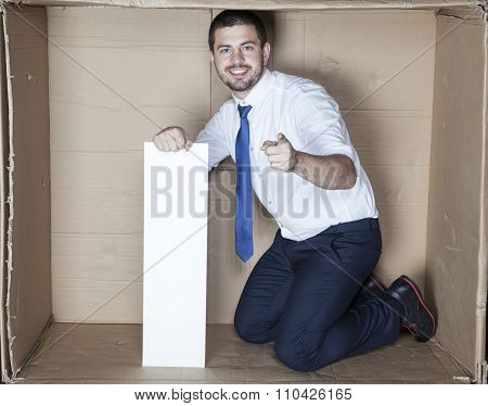 Businessman In The Small Office Pointing