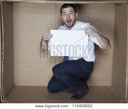 Surprised Businessman Holding A Piece Of Paper