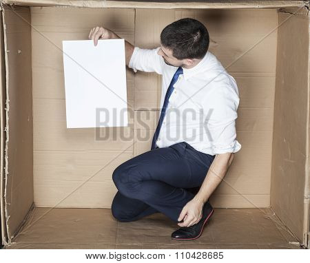 Businessman Looking On Paper