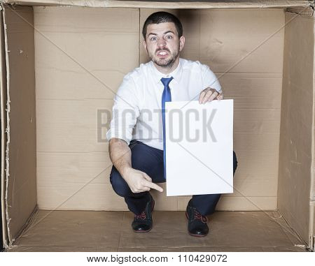 Angry Businessman Pointing Paper