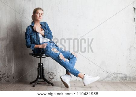 Woman In Jeans Sitting On Wooden Chair