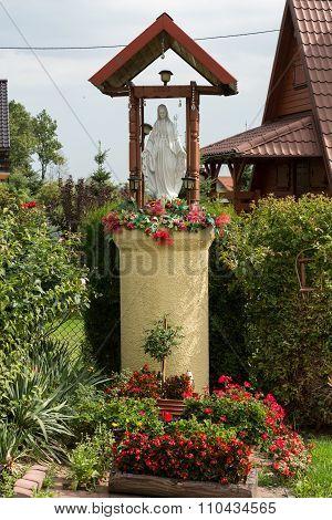 Old Wayside shrine in Mucharz near Cracow. Poland