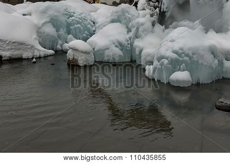 Frozen karst fountain in Bansko town at winter, Pirin mountain