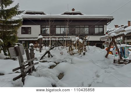 Snow winter square in the Bansko town with open-air kindergarten, Bulgaria